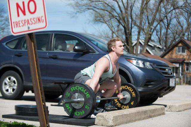 Nick Dondzila can't get to the gym, so he sets up his own in a parking lot.
