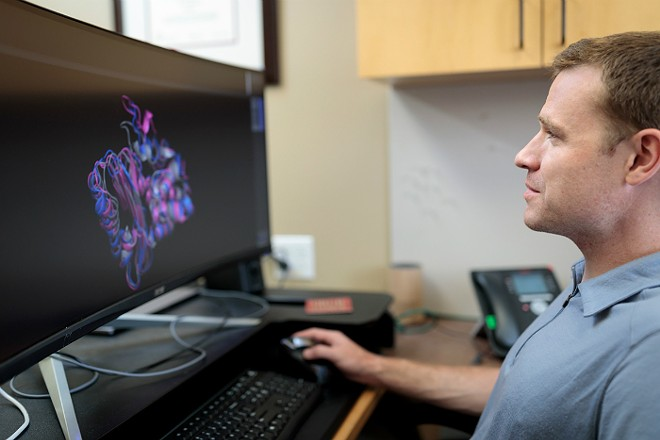 Dr. Gregory Bowman's team uses a distributed computing network to make massive computational problems more manageable. - MATT MILLER/WASHINGTON UNIVERSITY