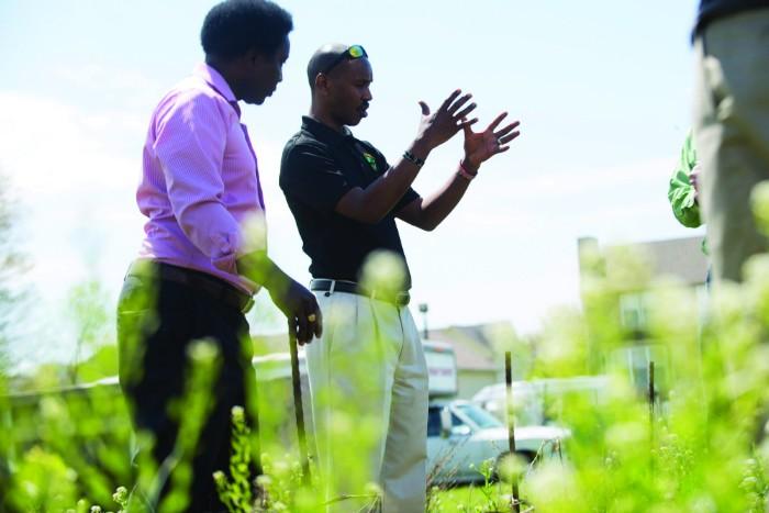 Pastor Paul Macharia and Geoffrey Soyiantet in the garden. - TRENTON ALMGREN-DAVIS