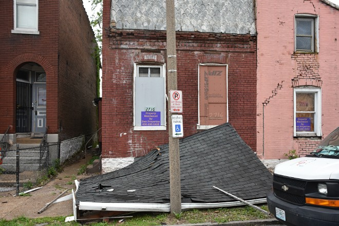 A roof was down on the sidewalk in front of a Utah Street house. - DOYLE MURPHY