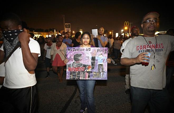 Protesters in 2014 in Ferguson. - STEVE TRUESDELL