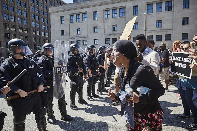 Maleeha Ahmad shouts at St. Louis police in 2017 after she was pepper sprayed while protesting the Jason Stockley verdict. - THEO WELLING