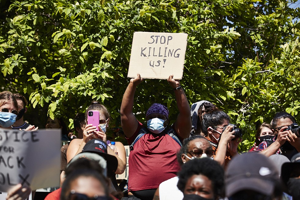 Among thousands at the Protest Against Police Murder, a woman has a request. - THEO WELLING