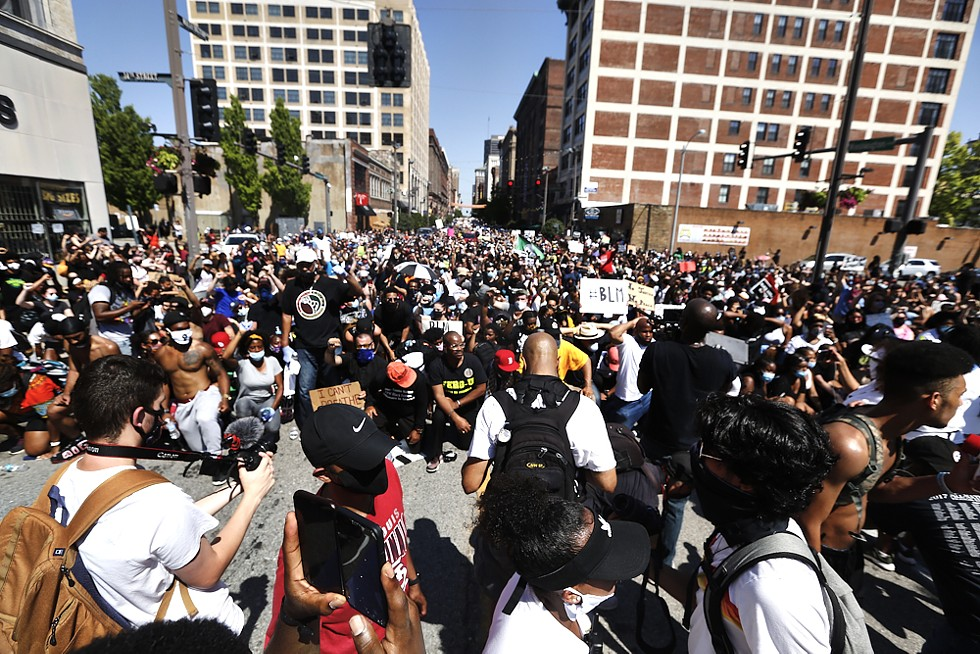 Thousands of people pause to reflect during the Protest Against Police Murder. - THEO WELLING