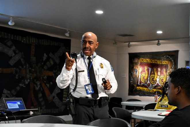 Capt. Perri Johnson speaks in 2018 to potential police recruits. - DOYLE MURPHY