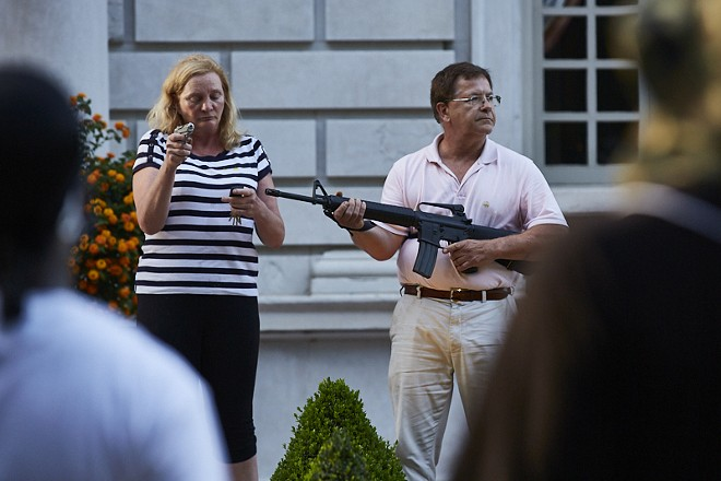 Patricia and Mark McCloskey confront protesters on June 28. - THEO WELLING