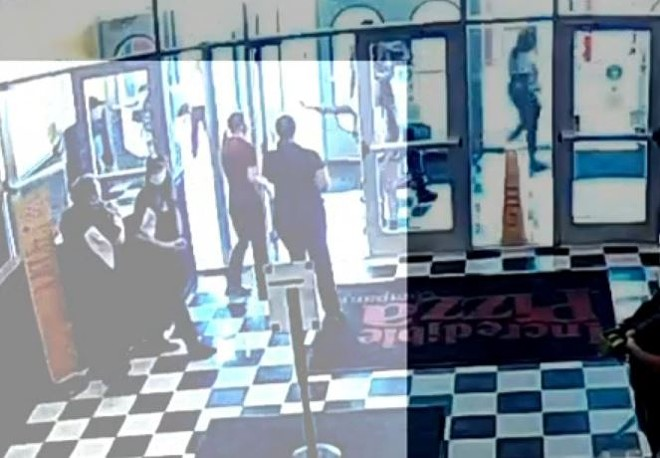 Security footage at the moment a customer who didn't want to wear a mask maced employees. - SCREENSHOT VIA KMOV