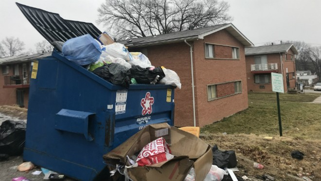 Dumpsters overflow with trash at Blue Fountain Apartments. - RYAN KRULL