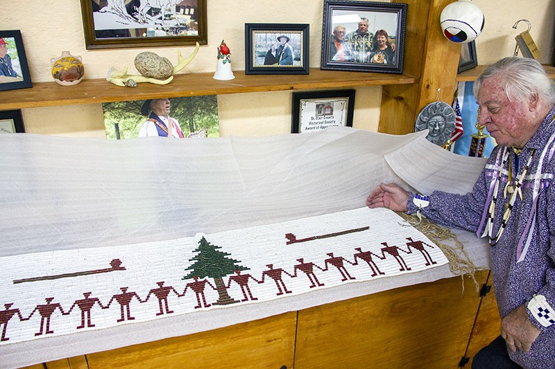 """Descombes poses next to what he describes as """"the largest known wampum belt."""" He says his proof of Cherokee heritage includes """"thousands of pounds"""" of secret genealogy records. - DANNY WICENTOWSKI"""