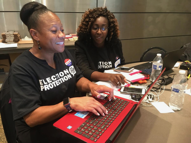 Two local attorneys from Mound City Bar Association working on voter issues on Election Day  during a past election at the St. Louis Command Center. - COURTESY MISSOURI VOTER PROTECTION COALITION