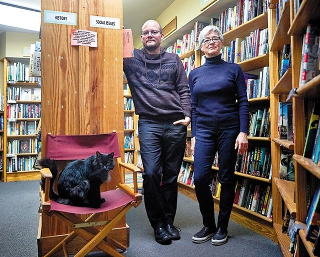 Left Bank Books co-owners Jarek Steele and Kris Kleindienst with Spike, the shop cat. - THEO WELLING