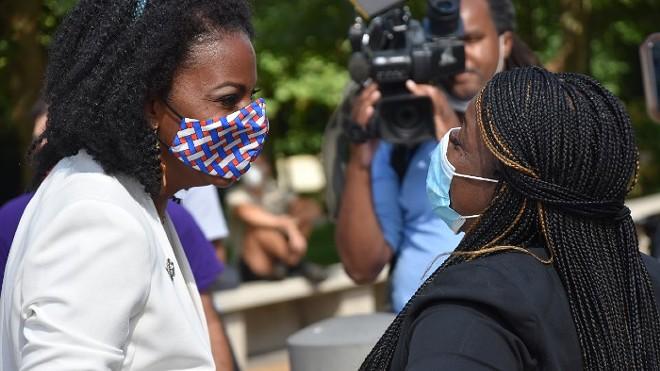 St. Louis Treasurer Tishaura Jones greets Cori Bush in August after their primary wins. - DOYLE MURPHY