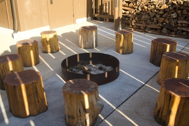 A fire pit keeps with the campground theme. - CHERYL BAEHR