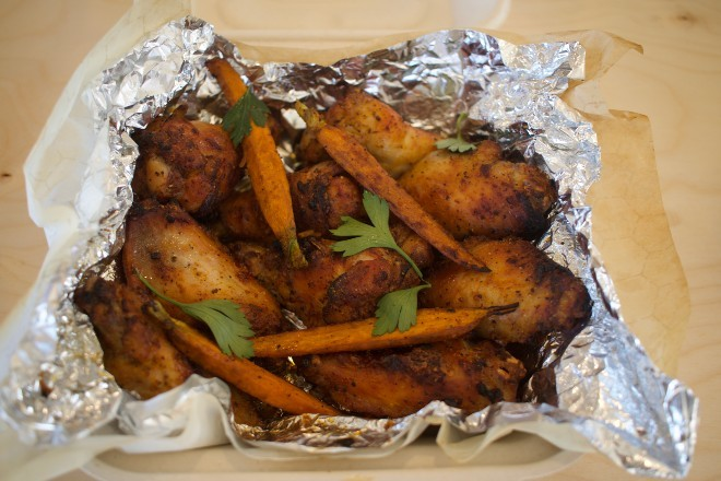 """The """"Blazed"""" wings are served with carrots and yogurt dressing. - CHERYL BAEHR"""