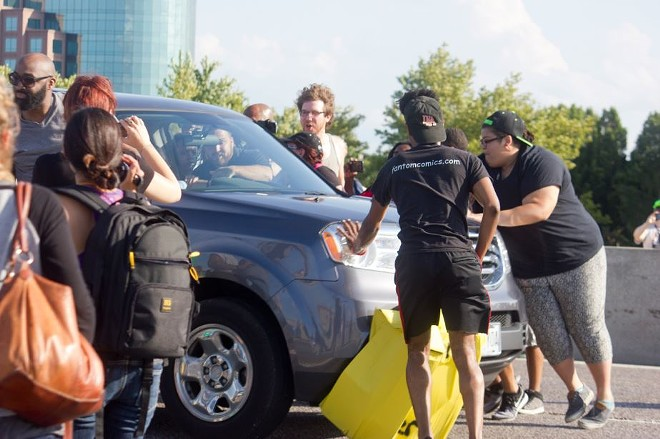 An unidentified female driver plowed her SUV through a line of protesters in 2015 on Interstate 70. - DANNY WICENTOWSKI