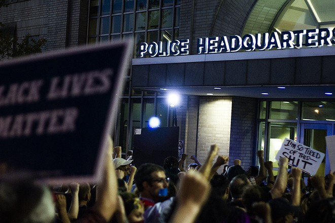 Protesters gather outside St. Louis police headquarters in 2017. - DANNY WICENTOWSKI