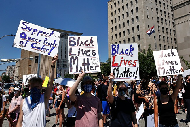 Thousands of protesters marched in downtown St. Louis last summer in an act of solidarity against police violence. - THEO WELLING