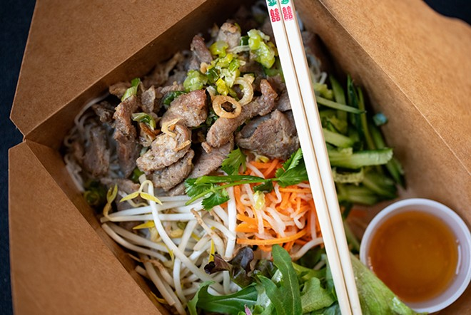 Grilled pork noodle bowl with rice noodles, mixed greens, bean sprouts, cilantro, pickled daikon, carrots and citrus-lime sauce. - MABEL SUEN