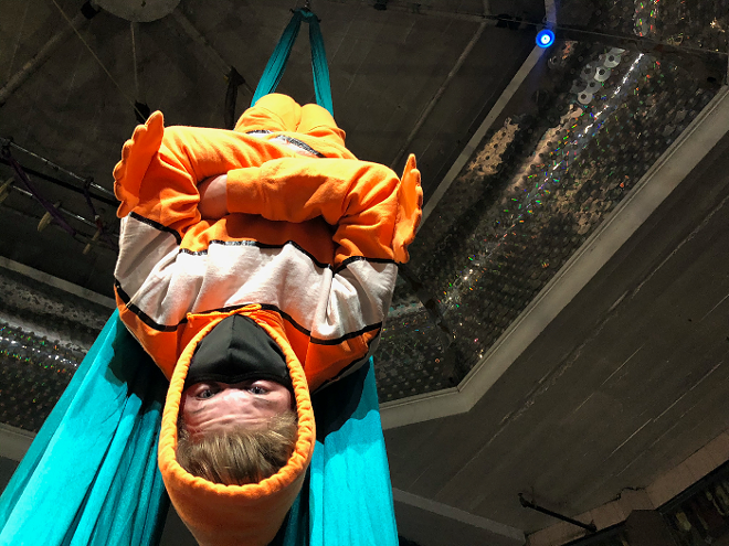 One student, donning a clownfish costume, performs in aerial silks before he becomes a sushi roll for his family's sushi recipe. - CIRCUS HARMONY