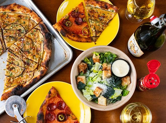 Bonci and pepperoni pizzas with Caesar salad. - MABEL SUEN