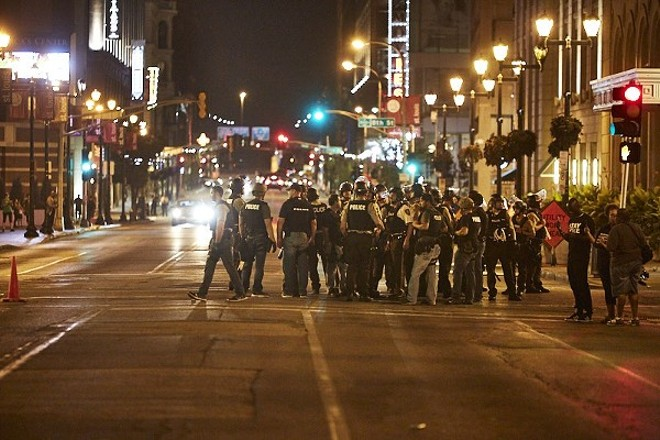 Police mass downtown on September 17, 2017, the night Detective Luther Hall was beaten and arrested while undercover. - THEO WELLING
