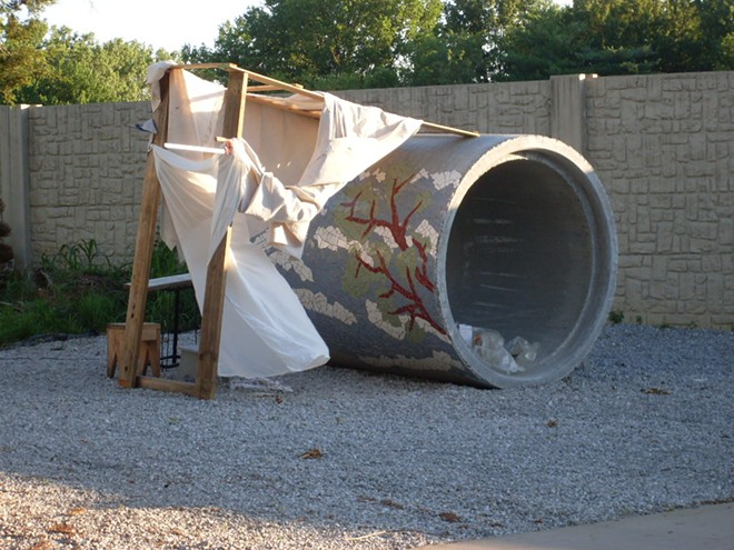 The pipe, shown here still partially covered in tile, was deemed nonfunctional for actually moving sewage — but it worked great for Spezia's unusual art project. - JEANNE SPEZIA