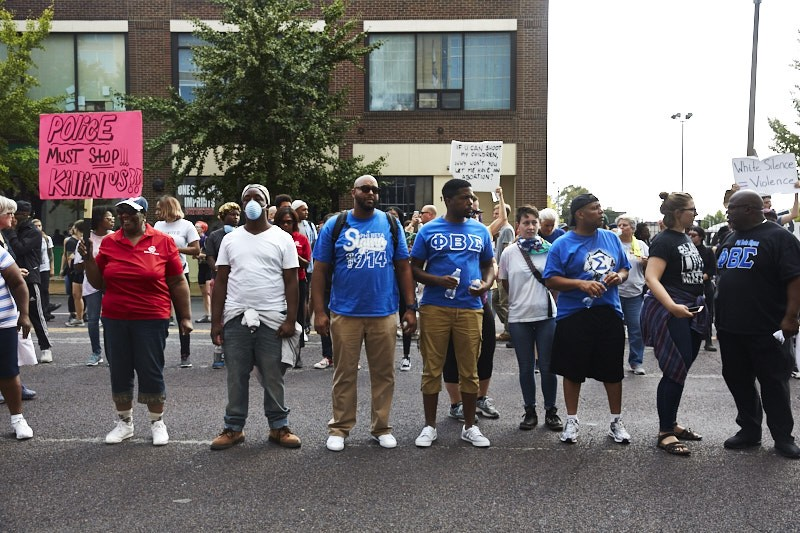 Activists outside of St. Louis police headquarters on Sept. 17, 2017, protest police killings following the acquittal of ex-St. Louis police officer Jason Stockley, who was charged with murder. - THEO WELLING