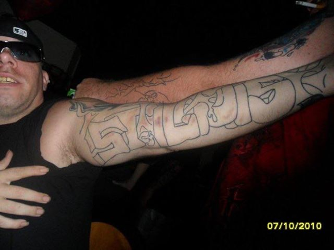"Samuel Israelsen's distinctive ""St. Louis"" tattoo helped investigators identify him. - COURTESY NAMUS DATABASE"