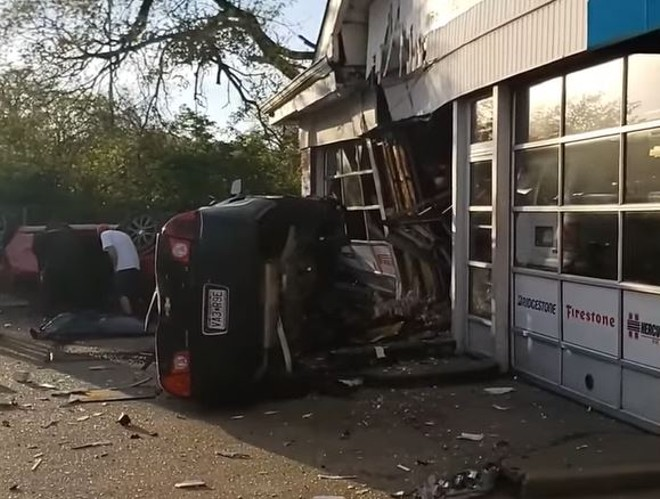 The aftermath of a fatal car accident in which a Chevy Malibu went airborne into a mechanic shop. - USED WITH PERMISSION/SCREENSHOT VIA FACEBOOK