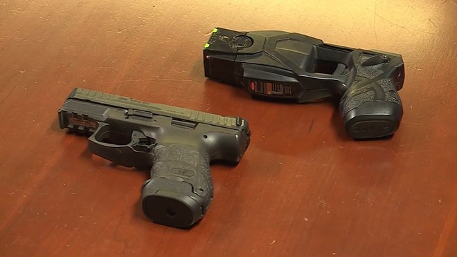 A comparison between the St. Ann police-issue Taser and sidearm  — both colored black. - SCREENSHOT VIA FOX2