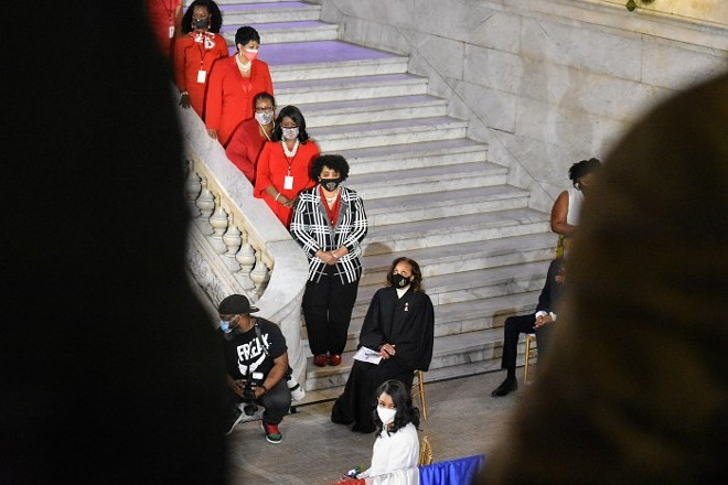 Tishaura Jones waits to be sworn in while her Delta Sigma Theta sisters in red stand in support. - DOYLE MURPHY