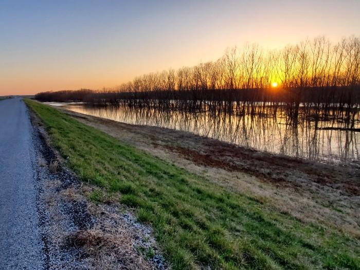 Sunset on the levee road in Illinois. - COURTESY MARK FINGERHUT