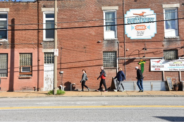From Left: Angela O'Hanlon, Glenn Hooker, Beth McEwen and Don Hovey walk along Southwest Avenue. - DOYLE MURPHY
