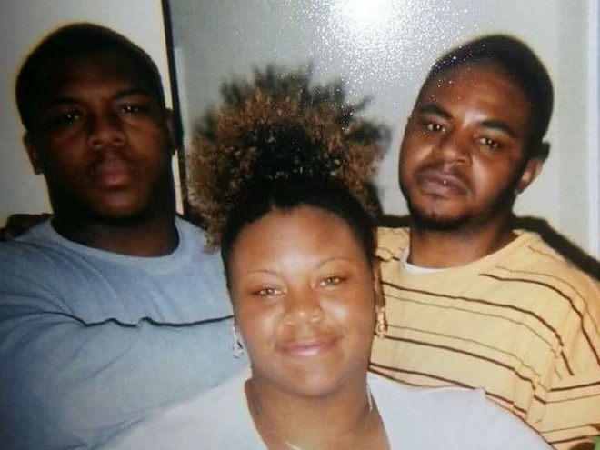 Robert Franklin (right), his mother, Dina, and younger brother. - COURTESY OF DINA FRANKLIN