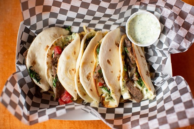 Gyro tacos, with mini flour tortillas stuffed with gyro meat, red onion, spinach, tomato and feta, served on a bed of potato sticks with a side of tzatziki. - MABEL SUEN