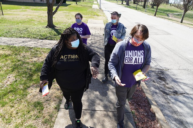 Kayla Reed (front left) joins volunteers from labor unions and NARAL Pro-Choice Missouri to knock on doors in a majority-Black neighborhood to advocate for Tishaura Jones in March. - LAWRENCE BRYANT