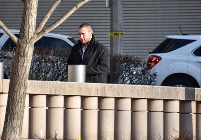 Ex-St. Louis cop Dustin Boone walks into federal court in 2018. - DOYLE MURPHY