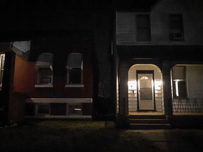 The gangway between 533 and 535 Bates Avenue is seen during the night in St. Louis on March 21, 2021. - ALISON FLOWERS/INVISIBLE INSTITUTE