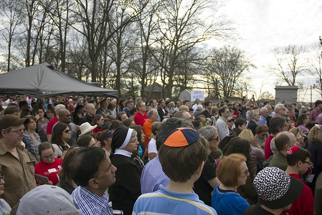 An interfaith crowd gathered for a vigil at the conclusion of the day's cleanup efforts. - PHOTO BY DANNY WICENTOWSKI