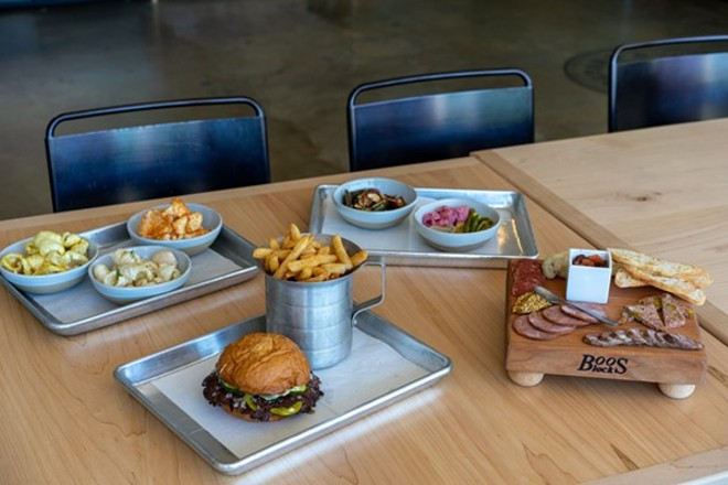 The new location's larger kitchen gives Bolyard and his crew the space to expand the menu with burgers, sides, charcuterie, salads and more. - HOLDEN HINDES