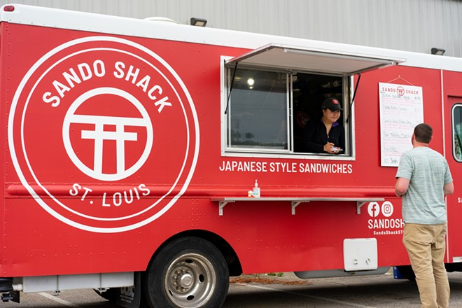 Amy Guo takes an order just after the truck opened for the evening. - HOLDEN HINDES