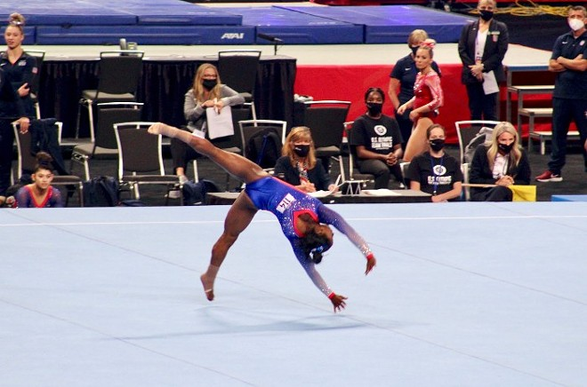 Simone Biles, the most highly decorated American gymnast, completes her floor routine at Friday's Olympic trials. - ZOE BUTLER