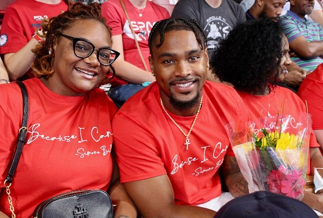 Houston Texans safety Jonathan Owens, who is also Simone Biles' boyfriend, smiles with his family in the stands of the Dome at Sunday's trials. - ZOE BUTLER