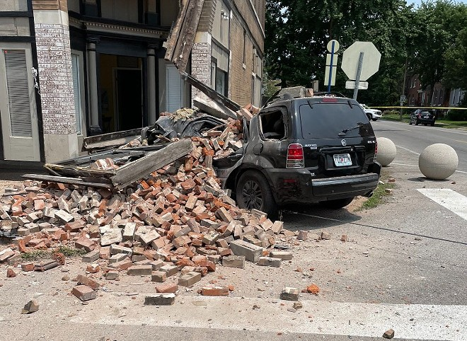 The SUV was mashed below a pile of bricks that fell off the building. - ST. LOUIS FIRE DEPARTMENT TWITTER