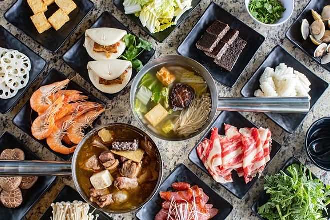 Ginger duck wok and beef hot pot with various add-ons, gua bao (pork belly bun) and sliced Taiwanese sausage. - MABEL SUEN