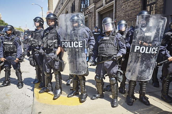 St. Louis police block protesters on Sept. 15, 2017, after ex-police officer Jason Stockley was found not guilty of murder. - THEO WELLING