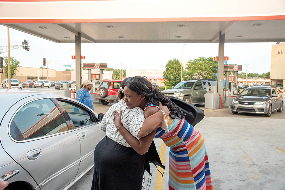 Pastor Pam, left, delivers lots of hugs during her travels. - ERIN MCAFEE