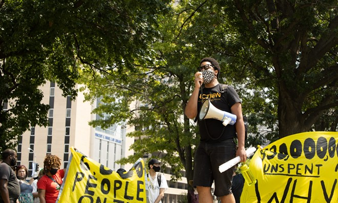 Activist and organizer Kennard Williams speaks to a crowd of about 40 protesters at Poelker Park on August 2, 2021. Williams and the crowd gathered to protest the end of the federal eviction moratorium. - JENNA JONES
