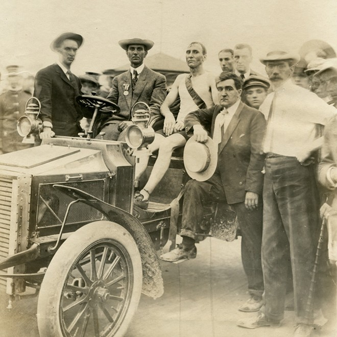 Hicks seated in a car after being declared the winner of the race. - COURTESY MISSOURI HISTORICAL SOCIETY