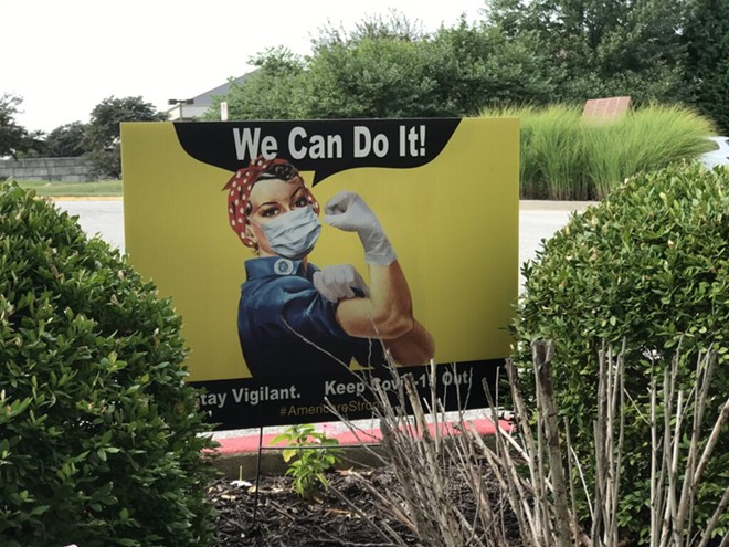 A sign outside The Neighborhoods by TigerPlace in Columbia, Mo, encourages visitors and staff to stay vigilant against COVID. - TESSA WEINBERG/MISSOURI INDEPENDENT